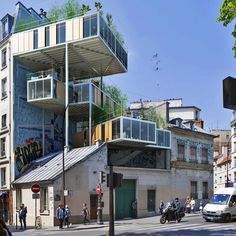 parasitic-rooftop-apartments-paris / new city codes allow outcrops to be added during a building's renovation