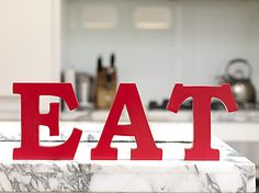 Give your kitchen a pop of colour with our super cute EAT letters in roaring red.