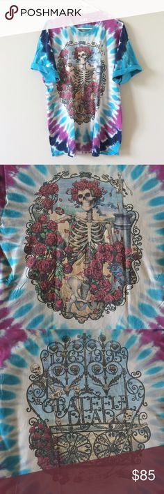 """Authentic Vintage Grateful Dead Tie Dye Tee LOWEST EUC 1995 Grateful Dead tee featuring the skull and roses artwork of Pat Maguire. Some wear along collar as this is an original from 1995 (Only one owner!) Measures 23"""" pit to pit and 31"""" long. Happy to post more pics or answer any questions! Unisex (mens) XL. Liquid Blue. No trades. Vintage Shirts Tees - Short Sleeve"""