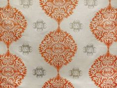 Alison Circles Linen Fabric Hand printed Orange and Grey Large floral design on Taupe Linen. Suitable for Curtains. Minimum order of 5 metres.