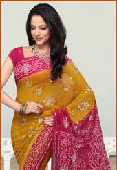 Yellow and fuchsia bandhej print, resham , sequins and  mirror work pure georgette saree.As shown faux crepe blouse fabric can be made available and the same can be customized in your style pattern subject to fabric limitation, as the fabric is just draped on the model.(Slight variation in colors is possible)
