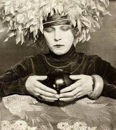 Curtis Moffat - Nancy Cunard with a crystal ball (1925)