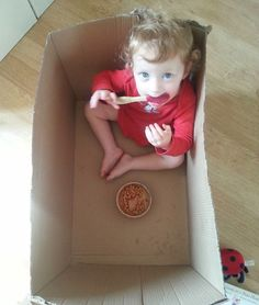 """Your child wants to eat """"ALONE!!!"""" with their plate and cutlery, but doesn't want to sit at the table? Offer to let them sit in a moving box. Most children find that awesome and exciting – and you'll have less mess to clean up afterward."""