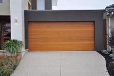 Emilio Modern Style Custom Wood Garage Door EMILIO by Pena. The Pena Modern Wood Doors Collection incorporates handcrafted wood to enhance its classic appe Garage Door Cost, Cedar Garage Door, Unique Garage Doors, Garage Door Panels, Custom Garage Doors, Carriage Garage Doors, Garage Door Springs, Garage Door Design, Industrial Garage Door