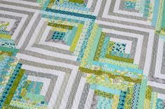 Log cabin pattern combining pretty aqua fabrics with grey/white neutrals. Nice. Hyacinth Quilt Designs