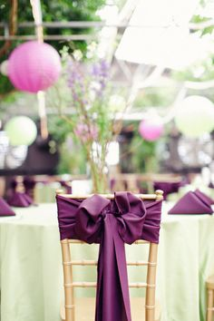 Deep purple chair sashes. Photography by foreverphotographystudio.com