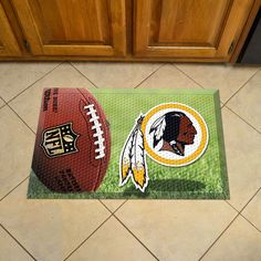 Washington Redskins Scraper Mat 19x30 - Ball - Scraper Mats by Sports Licensing Solutions are great for showing off your team pride in high traffic areas! Scraper Mats have nibs that scrape shoes clean of dirt, debris, and moisture so that your home stays clean. The debris is then trapped below the walking surface. Clean up is a breeze, just use a hose. Rubber construction ensures durability and mat features a high resolution image that won't fade! Textured backing keeps mat in place.FANMATS…