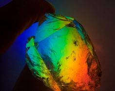 A really clear crystal of Quartz  held in front of a rainbow projected from a Leaded Crystal in the window. ThingOfInterestsOrigPhoto