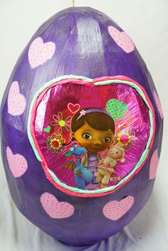 Check out our DocMcstuffins Egg or order something custom. Let us know :) They are like the New Pinatas but these Surprise eggs are usually filled with Toys instead of Candy. Order your Surprise egg now and fill it up with awesome prizes to bring smiles into the world! Formed with carefully measured and cut cardboard strips to make an egg shape, and reinforced with paper mache. Opening is cut in the back to fill and retrieve prizes. Can be reusable