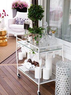 Pretty Porches and Terraces   Traditional Home - An antique tea cart serves as an outdoor minibar.