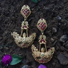 Product Details: Base Material - 92.5 Carat Pure Silver with Gold Plating Technique - Handcrafted Product Type - Temple Jewellery  Design - Jhumka Length - 9 cm  Width - 4 cm  Care Instructions - Avoid Contact with Perfumes and Water Contact No - +91 8095752326 E-Mail - contactus@madhurya.com   Also available in Pure Gold*  Shipping Worldwide