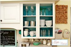 "Paint the inside of Kitchen (or other) Cabinets for a modern open cabinet or glass door style, or just to add a nice pop of color & ""surprise"" in traditional cabinets. Great way to ""remodel"" the look of a space without the expense of completely redoing it! (via Mom 4 Real)"
