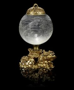 A large French ormolu-mounted glass fish bowl, engraved in the Oriental taste, and gilt-metal cover, circa 1900, possibly Baccarat.