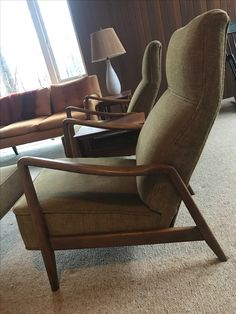 Chairs that I bought from a neighbor - they need reupholstering.  Pair of Dux Loungers