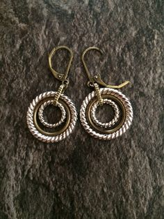 A personal favorite from my Etsy shop https://www.etsy.com/listing/400498539/silver-and-antique-brass-hoop-earrings