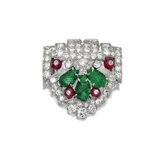Carved emerald, diamond and ruby brooch, circa 1925 | Sotheby's