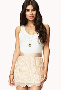 If we can't find exactly what you're looking for I bet we could find a close substitute. If we just get this skirt in coral, this would be really pretty too.