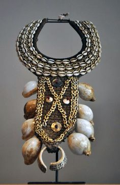 Woven Papua New Guinea necklace decorated with Kowrie Shells, Snail Shells and Mother of Pearl