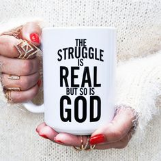 "The Struggle Is Real But So Is God Coffee Mug was designed to uplift you. Inspired by Isaiah 41:13, ""For I am the LORD your God who takes hold of your right hand and says to you, Do not fear; I will h"