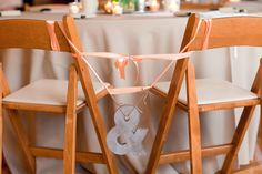 tied to the chairs- bride and groom  Handmade Amber Springs Wedding