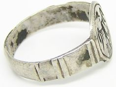 This is a fabulous medieval silver signet ring, dating to the 12th - 13th century. The Ring is a large and robust example, designed for a man to wear. It bears a Sicilian eagle device as a seal, bold and artistically engraved. The ring would have been worn by a nobleman during the reign of Frederick II, Holy Roman Emperor. This would have seen action during the period of the Crusades, in the Holy Land as favor or badge of office. No doubt this ring would have been worn by a Norman knight