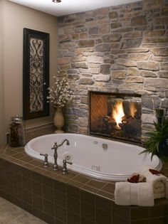 Fireplace between the master bedroom and tub--a dream bathroom!
