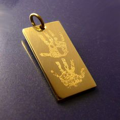 Handprints engraved on 9ct gold