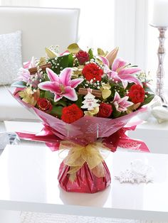 This gorgeous Christmassy bouquet will be a stunning surprise gift for someone special.