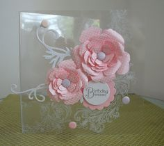 handmade card ... clear acetate base ... gorgeous dimensional flowers ... flourish stamped on the base ...