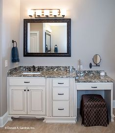 Vanity in the master bathroom with large storage drawers and a make-up station. The Spotswood - Plan 1310. http://www.dongardner.com/house-plan/1310/the-spotswood. #MasterBathroom #Luxurious #FloorPlan