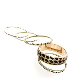 These eye-catching stacks of bangles will add an extra touch to your outfit.