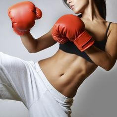 Fight for that flat tummy with this killer kickboxing workout routine for sexy abs!