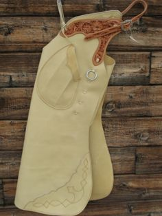 "Slickout Buck AZ Bells with Floral tooled yoke and belt. CowPuncher buckle. Outside pocket on Left. Boot Stitch on weight. Measurements 25"" Thigh, 39"" Outseam. $565.00."