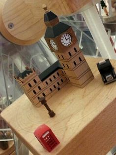A miniature world of Christmas in celebration  #small #mini #miniature #Christmas #celebration #festive #wood #funfair #BigBen #icon #taxi #cab
