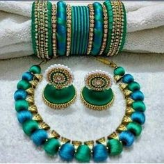 Buy silk thread bangles new design, silk thread necklace, silk thread earrings and jhumkas online. Customized Silk Thread jewellery set at best affordable prices for women's jewellery shopping online. Silk Thread Jhumkas, Silk Thread Bangles Design, Silk Thread Necklace, Silk Bangles, Beaded Necklace Patterns, Bridal Bangles, Thread Jewellery, Jewelry Patterns, Bridal Jewelry