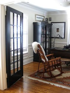 Idea #2: Who says interior doors have to be white? Not Matt & Kristin. In fact every single interior door in their house is stained a gorgeous ebony color- and it totally makes every space in their modestly sized bungalow pop with drama and definition