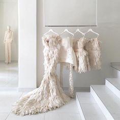 A fantasy rack of wedding weekend outfit options courtesy of Mihano Momosa Mihano Momosa, Feather Dress, Feather Art, Wedding Weekend, Weekend Outfit, Mode Outfits, Bridal Boutique, The Dress, Dress Long
