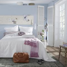 Décor de Provence...serene feel with the light blue walls, undertones of lavender and the crisp white.