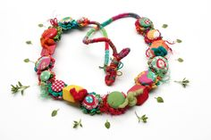 Colorful fiber art necklace, crochet, fabric buttons and wooden and felted beads, OOAK. $105.00, via Etsy.