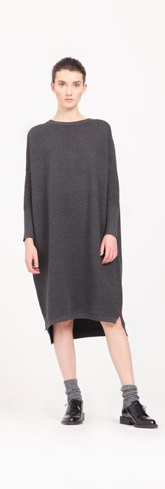 A dress version of our popular ribbed jumper, this ribbed jumper dress is designed with side splits, a round neckline and a dip hem. http://www.paisie.com/collections/knitwear/products/ribbed-jumper-dress-with-side-splits-in-charcoal