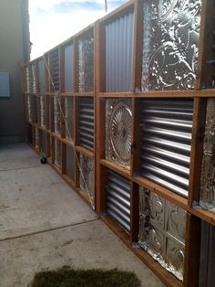 DIY corrugated metal fences project, how to build a fence with tin ceiling tiles. corrugated metal and wood.