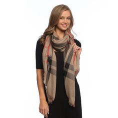 This versatile scarf is lightweight, super soft and comfortable, yet can provide real warmth on a chilly evening. The checkerboard plaid design is a great option for men or women.