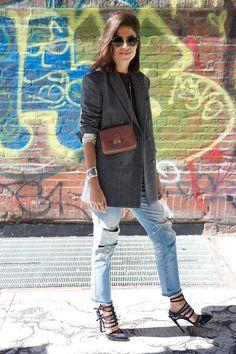 Leandra in Studio Nicholson blazer, Rxmance t-shirt, D-Squared jeans, Anthony Vaccarello heels, Ray Ban sunglasses.