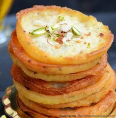 Hot and spicy pakoras with stuffing by chef sanjeev kapoor for shallow fried sweet pancakes of refined flour and milk by chef sanjeev kapoor for veg food recipesdessert forumfinder Images