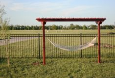 DIY your own Hammock Arbor. This would be great and you could put it anywhere.