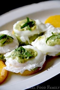 Eggs Benedict on Polenta Cakes with Pesto Hollandaise