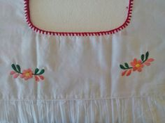 Traditional Handmade Embroidery mexican Blouse. Ideal for a boho and vintage chic look with Folk Fabric flowers, for everyday or beach, perfect to combine with denim. Match with a Embroidery Belt for a better look. (Available in MexicanArtsCrafts Shop) The colors are fantastic and the