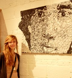 Chuck Close style portrait made with hundreds of pieces of painted cardboard!