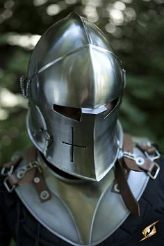 Helmet Visored Barbuta The Helmet Virsored Barbuta ia a completely closed helmet with artfully curved lines. The visor is fastened to the helmet with ornamented rivets and can be pushed up to open it. In addition the visor is...