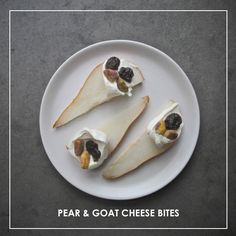 Pear & Goat Cheese Bites // shutterbean  A dollop of creamy goat cheese goes on top of a pear slice and gets bejeweled with dried cherries (cranberries are great too!) and roasted/ salted pistachios. This
